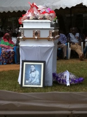 A portrait of Nanteza's picture on her coffin in Masaka, a few minutes before it was laid to rest, Photo by Yasin Kakande,