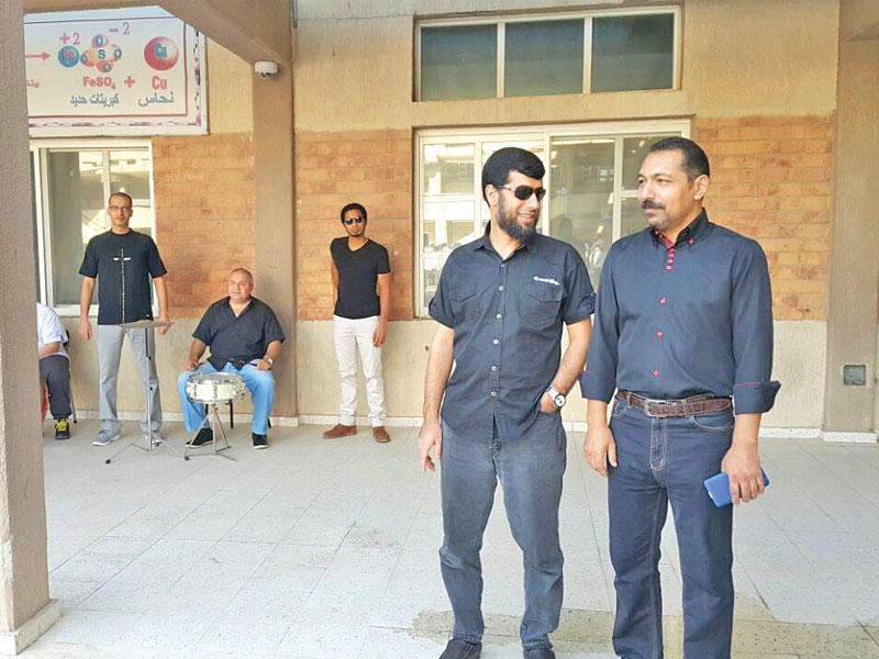 Expat teachers in Kuwait dress in black to express their objection to the new decision [Al-Jarida]