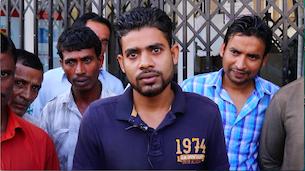 العمال العالقون في عُمان خلال حديثهم مع موقعنا