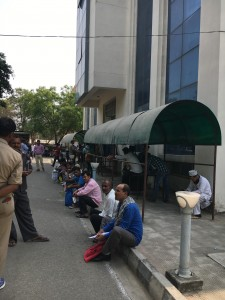 A steady crowd gather every morning at the emigration offices to process passports and visa work.